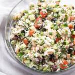 Greek shrimp salad in a glass bowl