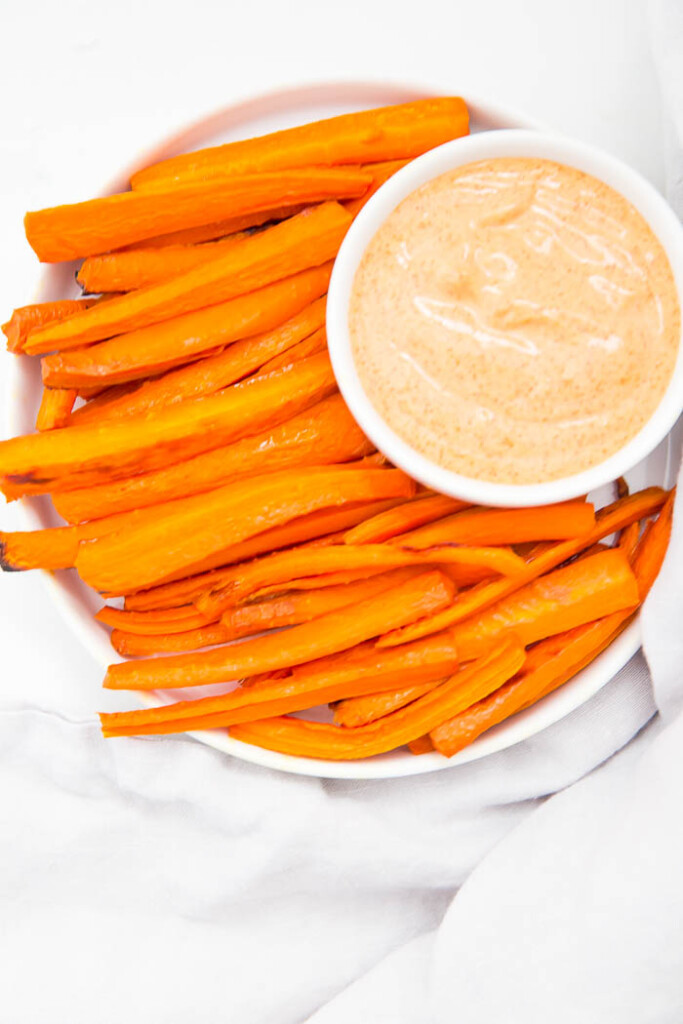 Plate of carrot fries with creamy paprika sauce.