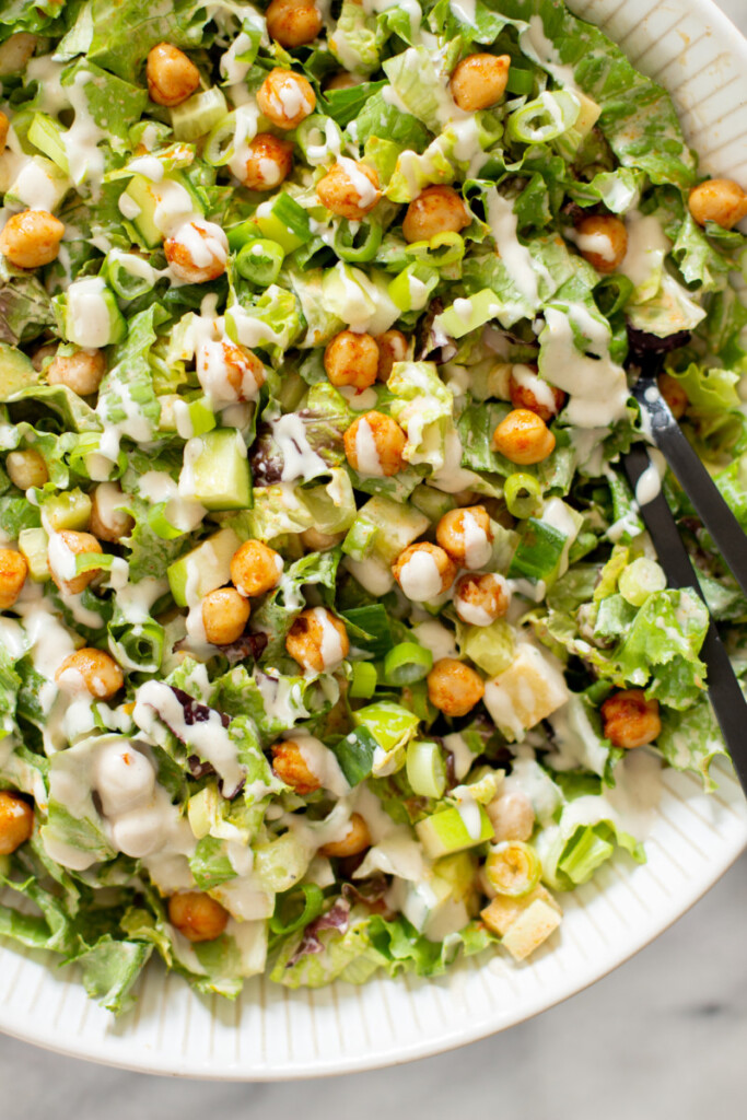 closeup image of chickpea salad with tahini dressing