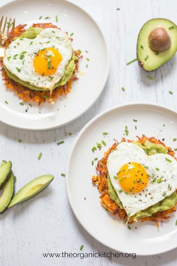 overhead shot of sweet potato fritters with fried egg and avocado