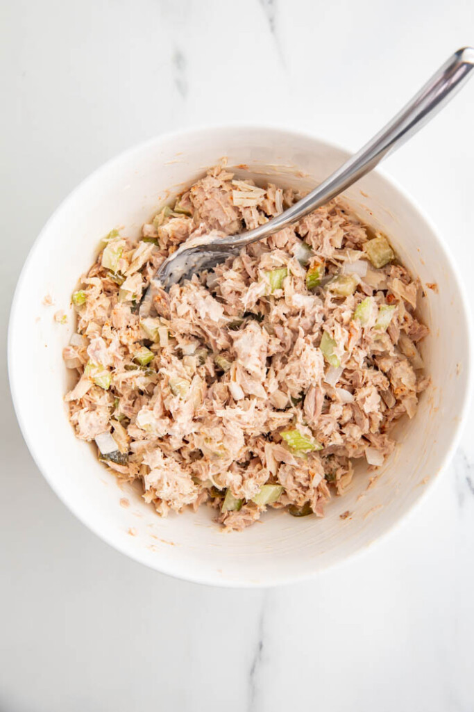 Tuna salad being mixed in a bowl