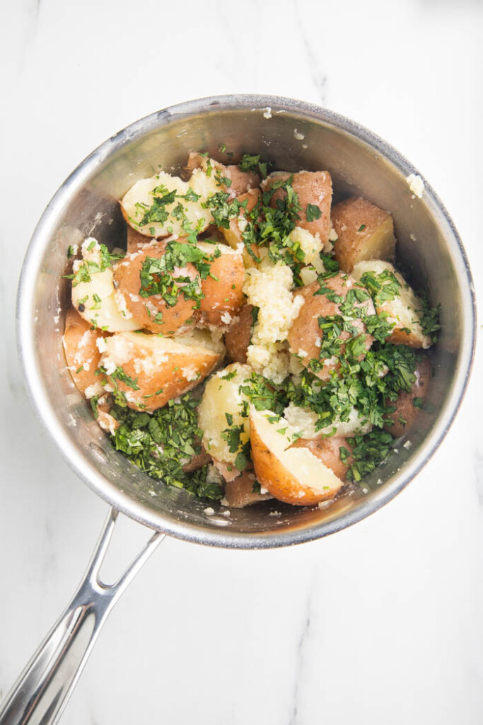 Garlic butter parsley potatoes in a pot