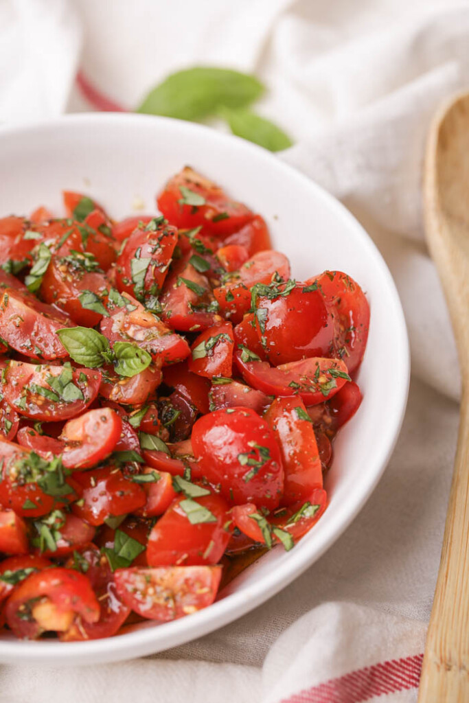 Close up of cherry tomato salad in a bowl