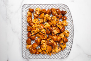 Marinated mushrooms resting on a air fryer tray