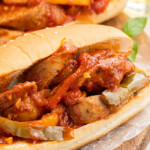 Two sandwiches filled with Instant Pot sausage and peppers
