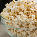 Air fryer popcorn in a glass bowl