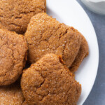 A white plate of 5 gluten free ginger snap cookies