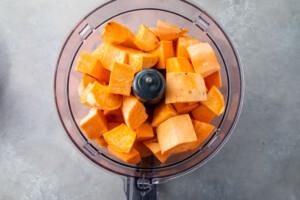 Peeled sweet potatoes in food processor