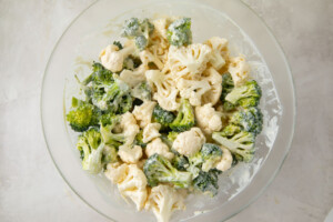 Cauliflower and broccoli in a large glass bowl