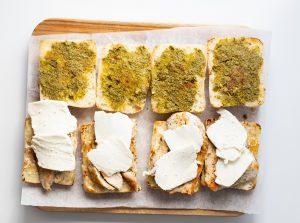 Ciabatta rolls with chicken and mozzarella on a cutting board