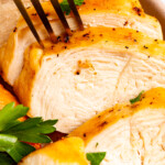 Close-up image of sliced chicken breast.
