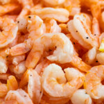 Close up image of a pile of cooked shrimp.