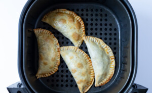 Air fryer empanadas in air fryer basket