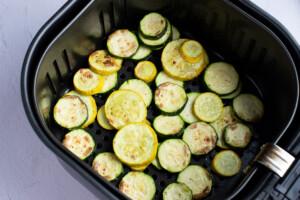 Air fried zucchini in an air fryer basket