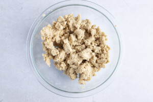 Streusel topping mixture for vegan coffee cake in large glass bowl